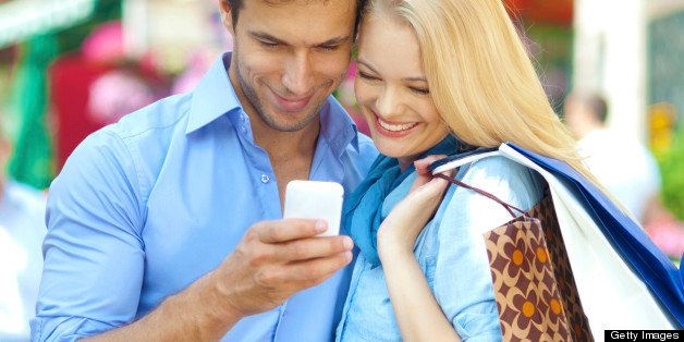 close up of a young couple looking at mobile phone