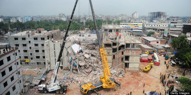 Bangladeshi rescuers work as Bangladeshi Army personel begin the second phase of the rescue operation using heavy equipment a