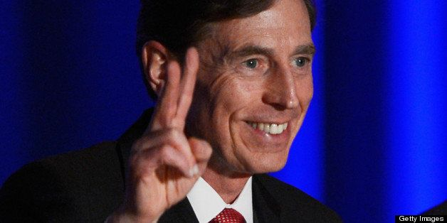 LOS ANGELES, CA - MARCH 26:  Former CIA director and retired four-star general General David Petraeus applauds as he makes hi