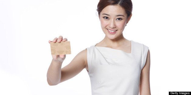 Young business lady holding credit card