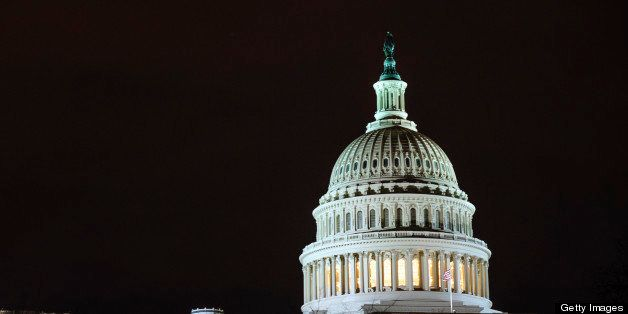 The dome of the U.S. Capitol is lit up in the evening in Washington, D.C., U.S., on Thursday, Feb. 28, 2013. Democrats and Re