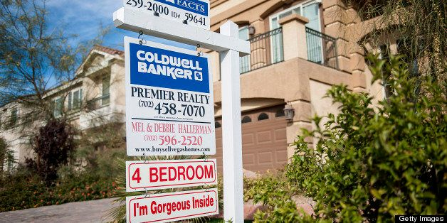 A Coldwell Banker LLC sign is displayed outside of a house for sale in Las Vegas, Nevada, U.S., on Tuesday, Nov. 27, 2012. La