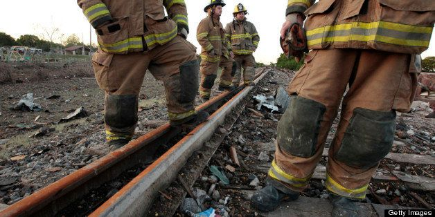 WEST, TX - APRIL 18: Valley Mills Fire Department personnel view the railroad tracks near to the fertilizer plant that explod