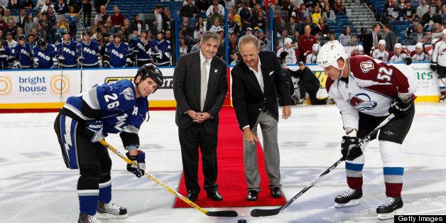 TAMPA, FL -DECEMBER 4:  Steve Yerrid drops the ceremonial puck with Jeffery Vinik, owner of the Tampa Bay Lightning along wit