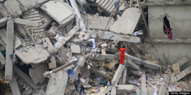 A Bangladeshi volunteer stands amid rubble as he assists in rescue operations after an eight-storey building collapsed in Sav