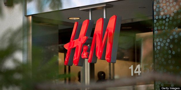 Hennes & Mauritz AB (H&M) signage is displayed outside of a store at the Third Street Promenade outdoor mall in Santa Monica,
