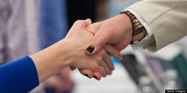 A job seeker shakes hands with a recruiter at the Spring LGBT Career Fair in San Francisco, California, U.S., on Wednesday, A