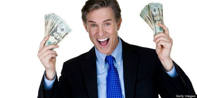 Horizontal composition of a mature man wearing a suit and holding money