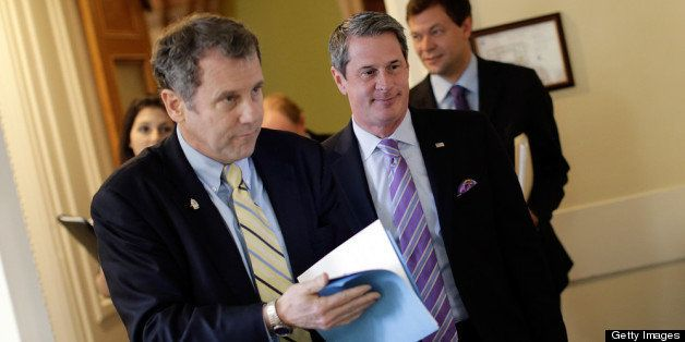 WASHINGTON, DC - APRIL 24:  Sen. Sherrod Brown (D-OH) (L) and Sen. David Vitter (R-LA) (R) arrive for a press conference anno