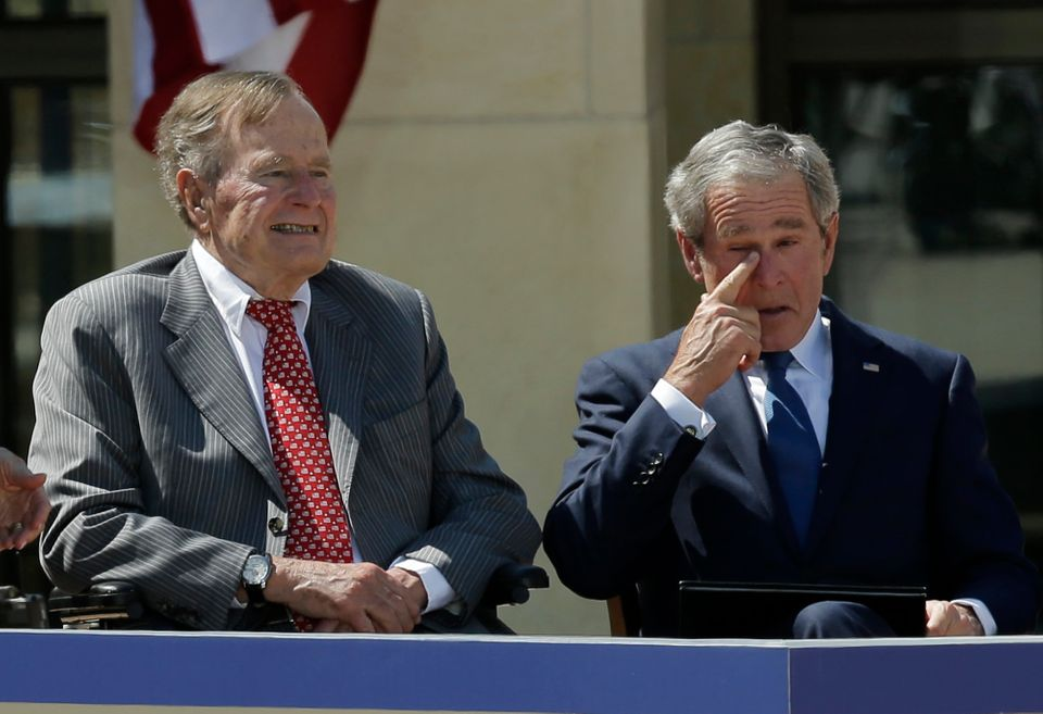 Former president George W. Bush, wipes a tear after his speech during the dedication of the George W. Bush presidential libra