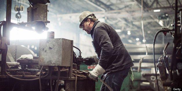 Man Working At Steel Cutting Machine