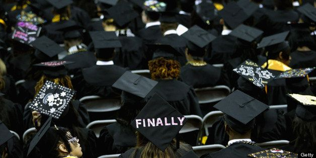 COLLEGE PARK, MD - MAY 17:  Graduates of Bowie State University put messages on their mortarboard hats during the school's gr