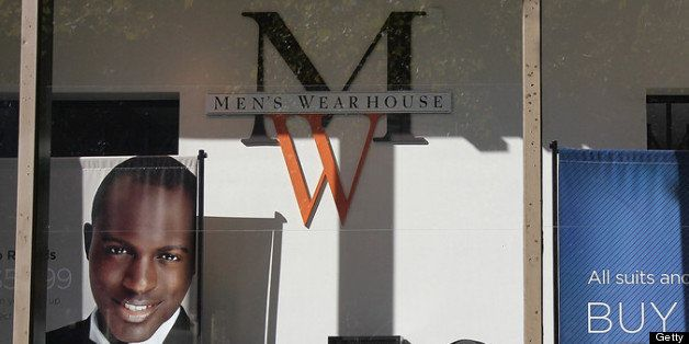 OAKLAND, CA - NOVEMBER 02:  A sign hangs in the window of a Men's Wearhouse store in solidarity with Occupy Oakland's general