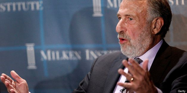 George Zimmer, founder and executive chairman of The Men's Wearhouse Inc., speaks during a panel discussion at the annual Mil