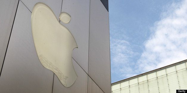 The Apple Inc. logo is displayed outside the company's store in Tokyo, Japan, on Sunday, June 23, 2013. Samsung and Apple, th