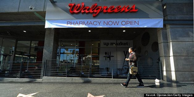 HOLLYWOOD, CA - JANUARY 15:  A woman walk past a new Walgreens at the corner of Sunset and Vine on January 15, 2013 in Hollyw