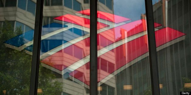 The Bank of America Corp. logo is displayed inside of a branch in Charlotte, North Carolina, U.S., on Wednesday, May 8, 2013.