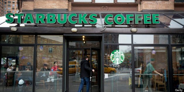 A customer enters a Starbucks Corp. location in New York, U.S., on Tuesday, April 23, 2013. Arabica-coffee futures fell the m