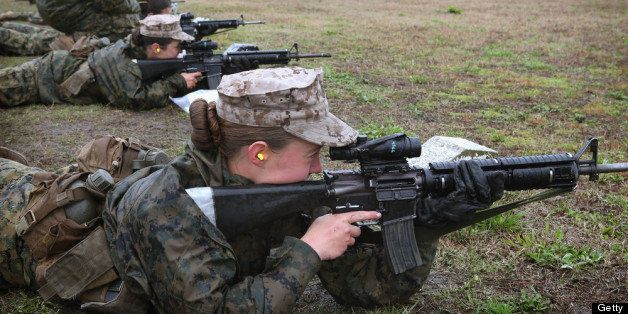PARRIS ISLAND, SC - FEBRUARY 25:  Female Marine recruits fire on the rifle range during boot camp February 25, 2013 at MCRD P