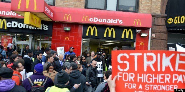 A coalition of groups rally in front of a McDonald's on East 125th Street and Lexington Avenue in Harlem during a protest by