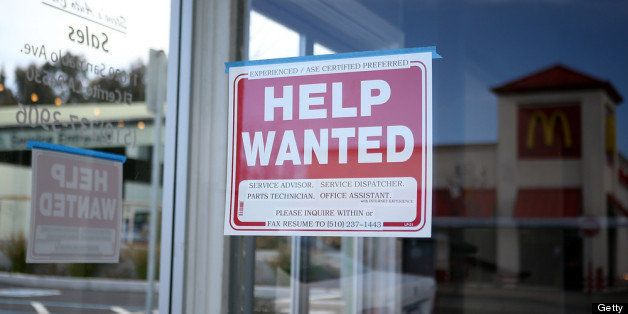 EL CERRITO, CA - MARCH 08:  A 'Help Wanted' sign is posted in the window of an automotive service shop on March 8, 2013 in El