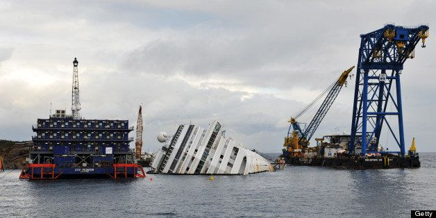 GLIO PORTO, ITALY - JANUARY 14: The sunken Costa Concordia remains in the water the day after the commemoration for the victi