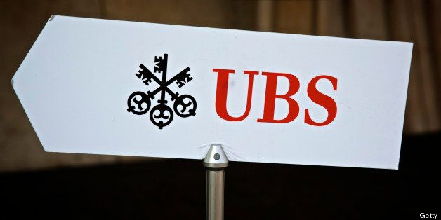 The UBS AG logo sits on a sign outside the bank's offices in Basel, Switzerland, on Tuesday, July 23, 2013. Europe's biggest