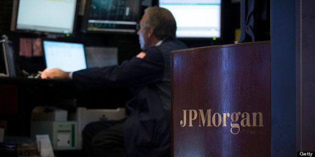 The JP Morgan logo is displayed on the floor of the New York Stock Exchange (NYSE) in New York, U.S., on Monday, July 29, 201
