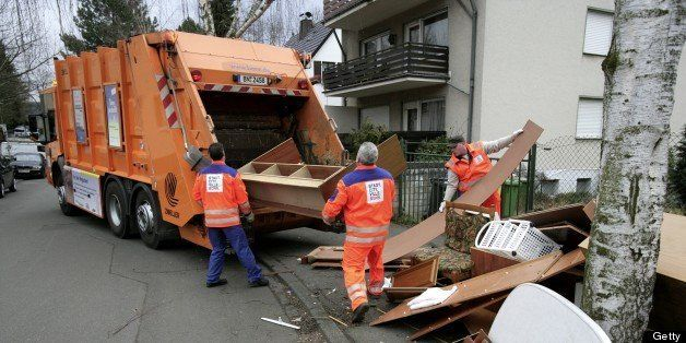 GERMANY - MARCH 01: GERMANY, BONN, bulky waste being collected from garbage collectors with a garbage truck. (Photo by Ulrich