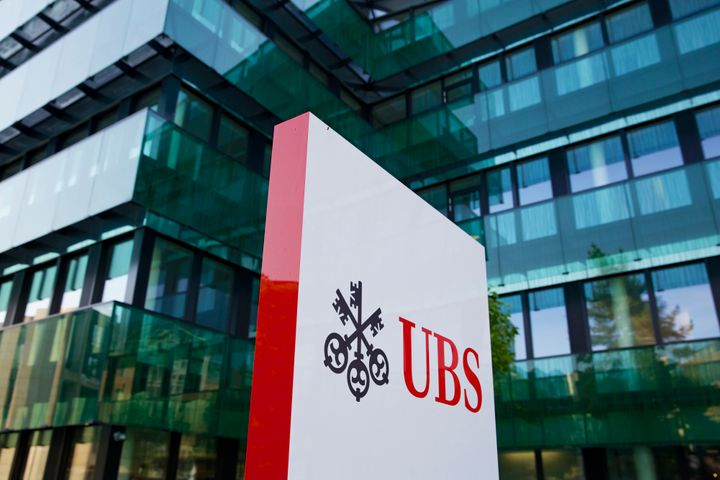 The UBS AG logo stands outside the bank's offices in Basel, Switzerland, on Tuesday, July 23, 2013. Europe's biggest banks, w