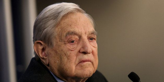 George Soros, founder of Soros Fund Management LLC, pauses while speaking during a forum session on the opening day in Davos,