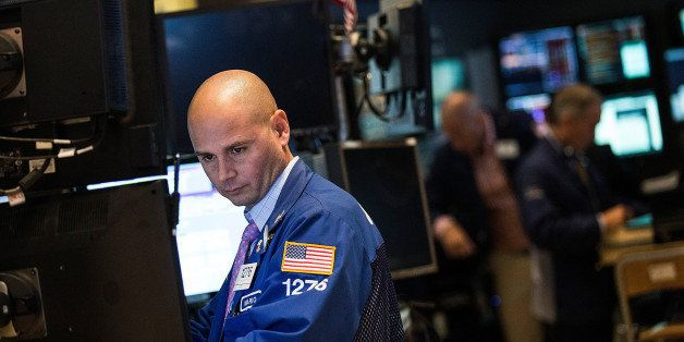 NEW YORK, NY - AUGUST 06:  A trader works on the floor of the New York Stock Exchange at the end of the trading day on August