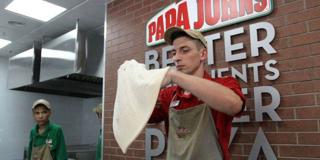 An employee shapes dough for a pizza base at a Papa John's International Inc. pizza restaurant in Moscow, Russia, on Tuesday,