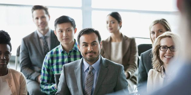Group of business people at presentation in office building
