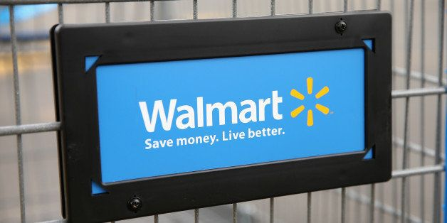 CHICAGO, IL - AUGUST 15: The Walmart logo is displayed on a shopping cart at a Walmart store on August 15, 2013 in Chicago, I