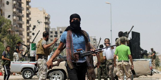 Syrian rebels fighting pro-regime forces gather along a road in Syria's eastern town of Deir Ezzor, on August 17, 2013. Al-Qa