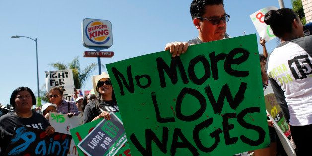 Fast-food workers and supporters organized by the Service Employees International Union (SEIU) protest outside of a Burger Ki