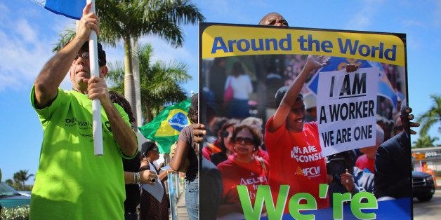 HIALEAH, FL - DECEMBER 14: Protesters participate in a 'Global Day' of action against Walmart on December 14, 2012 in Hialeah, Florida. The protesters in partnership with the global union federation UNI, the union-affiliated group Making Change at Walmart joined others around the world to among other things call for an end to alleged retaliation against US Walmart worker activists. (Photo by Joe Raedle/Getty Images)