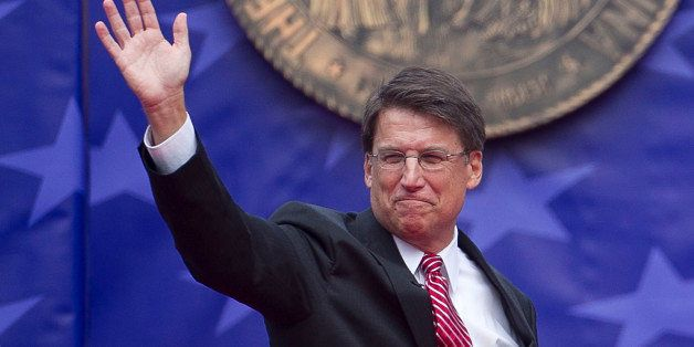North Caorlina Gov. Pat McCrory waves to the crowd after taking the oath of office at the North Carolina State Capitol in Ral