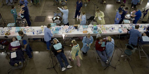 KNOXVILLE, TN - JANUARY 31: Patients lined up for dental treatment in the dental care area at the makeshift hospital with alm