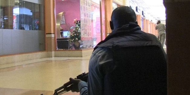 An image grab taken from AFP TV shows a member of the Kenyan security forces taking position inside a shopping mall following