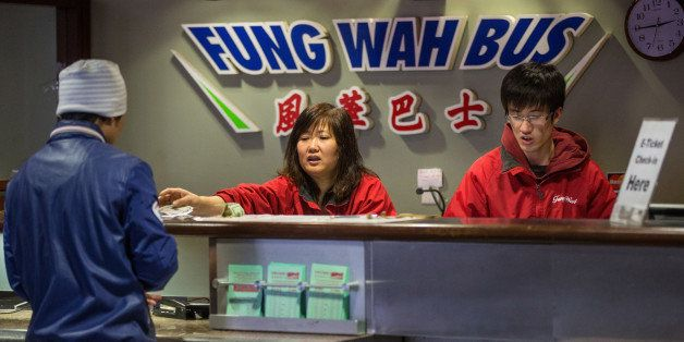 BOSTON - FEBRUARY 26: A worker at the Fung Wah Bus ticket booth sold passengers tickets for a 3 p.m. Fung Wah bus headed to N