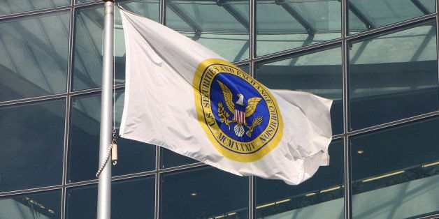 UNITED STATES - OCTOBER 26: A flag waves in front of the headquarters of the Securities and Exchange Commission in Washington, D.C., October 26, 2006. The SEC, criticized by Congress for its handling of a trading probe that entangled Morgan Stanley Chief Executive Officer John Mack, faces a broad review by government auditors of its management and methods for policing the financial markets. (Photo by Dennis Brack/Bloomberg via Getty Images)