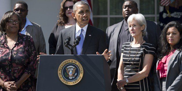 US President Barack Obama speaks alongside Secretary of Health and Human Services Kathleen Sebelius (R) and people who will b