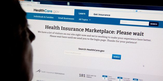A woman looks at the HealthCare.gov insurance exchange internet site October 1, 2013 in Washington, DC. US President Barack O