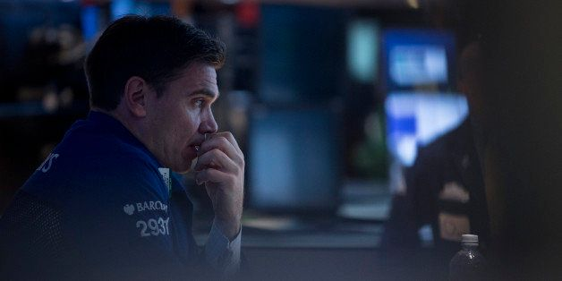 A trader works on the floor of the New York Stock Exchange (NYSE) in New York, U.S., on Wednesday, Oct. 9, 2013. U.S. stocks