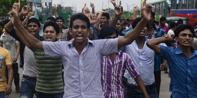 Bangladeshi garment workers shout slogans during a protest in Dhaka on September 23, 2013. Angry Bangladeshi garment workers