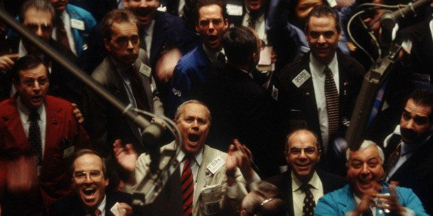 347769 09: Traders on the floor of the New York Stock Exchange cheer after the Dow Jones Industrial Average surpassed 10,000