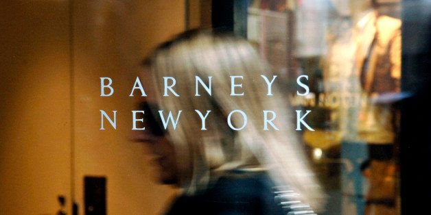 UNITED STATES - MARCH 16:  A Barneys New York logo is pictured as a woman enters their 5th Avenue store in New York, Tuesday,