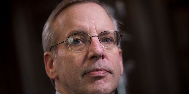 William C. Dudley, president and chief executive officer of the Federal Reserve Bank of New York, chats before an interview i